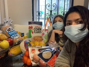 providing food in a pandemic. Volunteers with groceries from local supermarkets