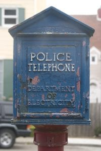 policing and segregation. Image of police telephone box, with peeling paint