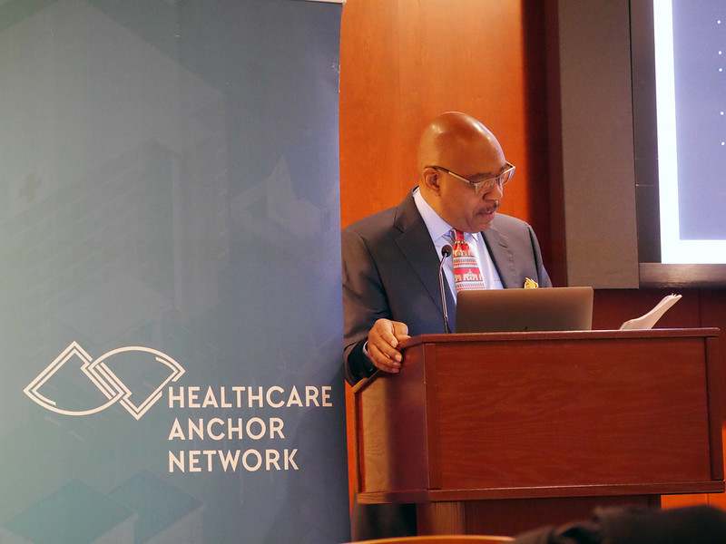 social determinants of health: photo shows Dr. Sam Ross at lectern at Health Policy Day 2020