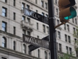 expanding CRA. Image shows Wall Street street sign