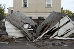 colonias. Stock image shows house collapsed from flood damage