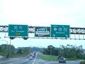 """Image shows highway sign """"Welcome to New Jersey"""""""
