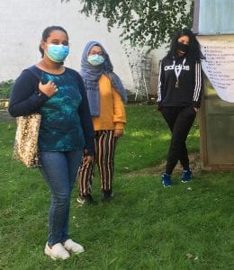 Asian community. Image shows three teenagers at an in-person event at SAYA