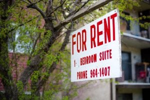 A for rent sign for a 1 bedroom suite. New companies are coming out to ease the burden of coming down with a lump sum security deposit, but are they really helping tenants?