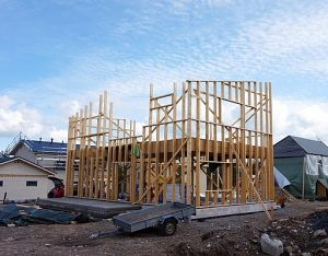 housing equity: photo shows a house under construction