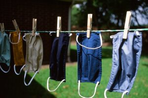 affordable housing asset management: photo shows COVID-19 masks drying on a clothesline