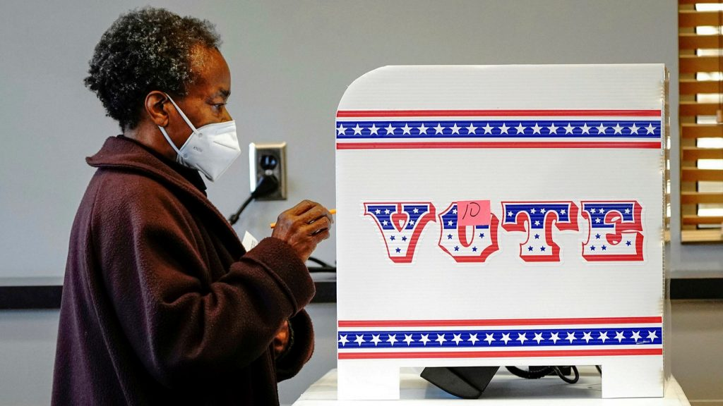 ballot measures: photo shows a woman casting a ballot