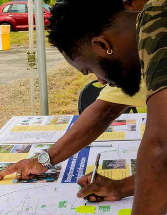 image shows people examining a map, as part of equitable development planning in Baton Rouge