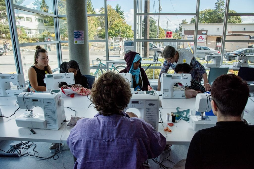 Yesler residents participate in a sewing workshop, one of several arts and culture programs available to residents.