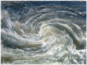 aerial photo of an ocean whirlpool, illustrating an article about the pitfalls of common assumptions underlying place-based work.