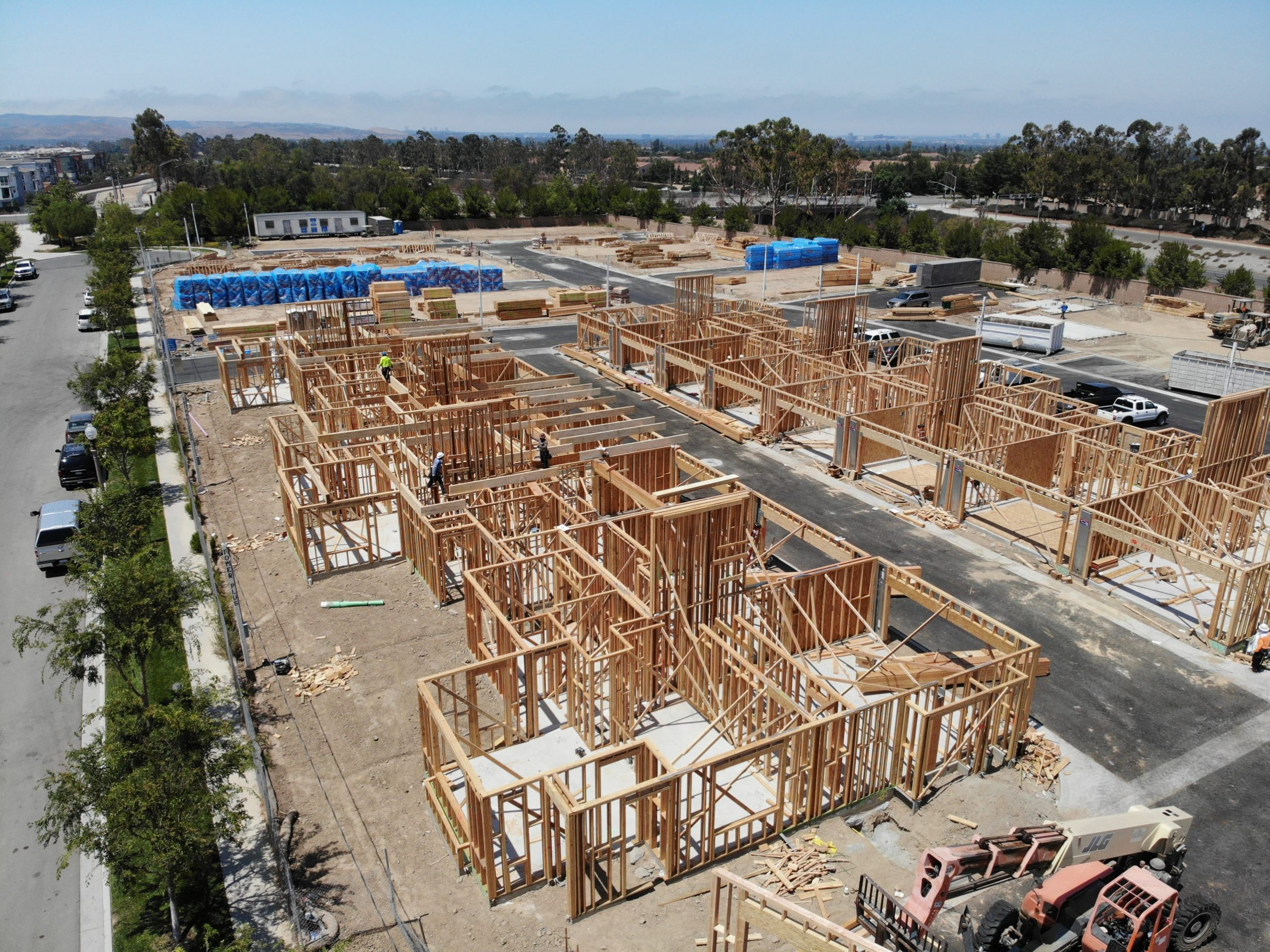 Some community land trusts are aiming for larger scale than has been typical. Here shows a 68-unit affordable townhome development being built -- large blocks of wood show where units will be. Irvine CLT will operate the site.