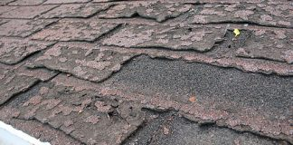 Close-up view of dilapidated asphalt roof shingles