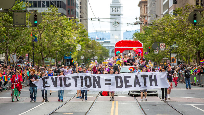 Marchers hold a banner reading 'Eviction = Death'