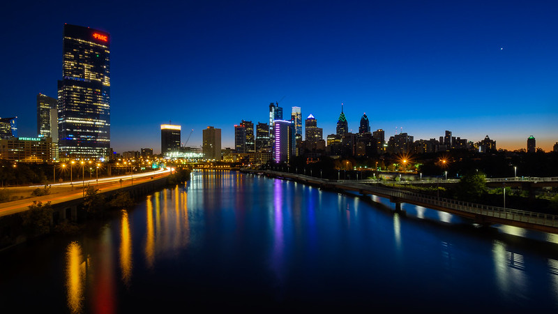 A view of Philadelphia along the Schuylkill River at sunrise, illustrating an article about the city's nonprofit hospitals teaming up to conduct the CHNA (community health needs assessment)