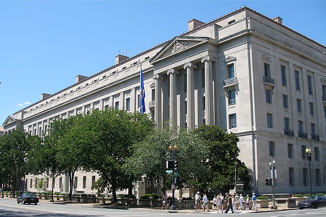 View of the Department of Justice in Washington, D.C., illustrating an article on the reopening of the department's Office for Access to Justice and its relation to the right to counsel movement for tenants facing eviction